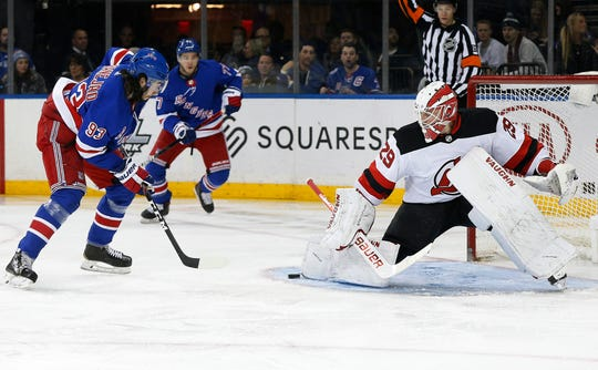 New Jersey Devils goaltender Mackenzie Blackwood (29) makes a save on a close in shot by New York Rangers center Mika Zibanejad (93) during the second period at Madison Square Garden.
