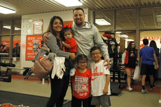 Artesia head coach Michael Mondragon celebrates the win with his family.