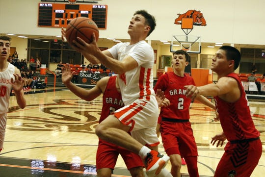 Artesia's Cord Cox gets a layup against Grants in the fourth quarter of their game on March 7, 2020. Artesia won, 54-48 and will face Hope Christian in the 4A quarterfinals on March 11.