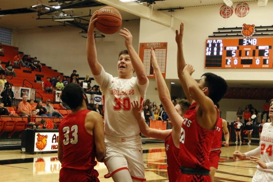 Artesia's Clay Houghtaling goes for a contested fastbreak layup against Grants in the first quarter of their game on March 7, 2020. Houghtaling finished with 12 points. Artesia won, 54-48 and will face Hope Christian in the 4A quarterfinals on March 11.