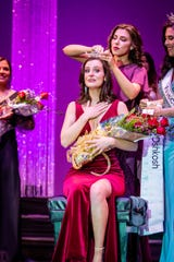 Miss Oshkosh 2020 Breah Ostertag gets crowned Saturday by 2019 titleholder Katrina Mazier at the annual scholarship competition at the Alberta Kimball Auditorium.