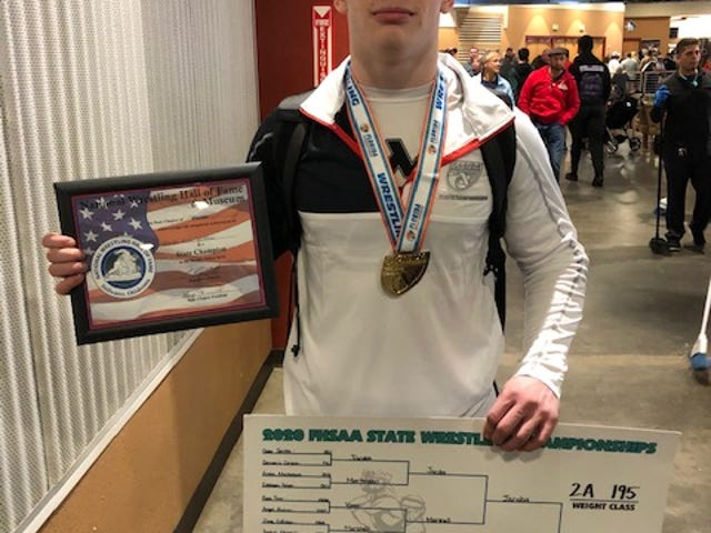 Pace senior Gabe Jacobs celebrates his FHSAA state championship in the Class 2A 195-pound division. Jacobs is the first public school wrestling state champion from the Pensacola metropolitan area.