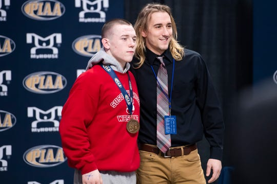 Susquehannock's Colby Romjue receives his eighth-place medal at the PIAA 3A championships in the Giant Center in Hershey Saturday, March 7, 2020.