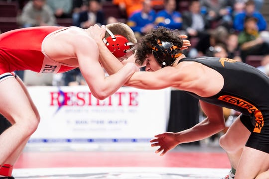 Central York's Mason Myers wrestles Red Land's Bryce Brennan in the PIAA 3A 132-pound seventh-place bout at the Giant Center in Hershey Saturday, March 7, 2020. Brennan won, 3-1.