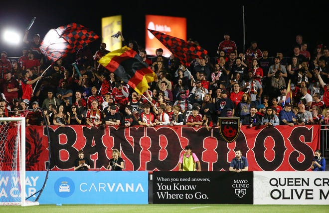 Phoenix Rising FC fans wave flags during the season opener against Portland Timbers 2 at Casino Arizona Field on Mar. 7, 2020 in Scottsdale, Ariz.