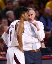 Arizona State head coach Bobby Hurley talks to guard Remy Martin (1) against Washington State in the first half on Mar. 7, 2020 at Desert Financial Arena in Tempe, Ariz.