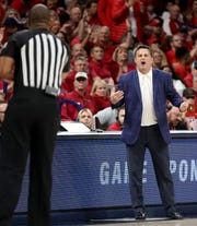 Arizona head coach Sean Miller implores one of the game officials to make the call during a break in action against Washington in the first half of their Pac-12 game at McKale Center, March 7, 2020, Tucson, Ariz.