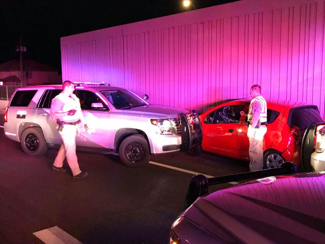 Officials arrested Hector Javier Smith-Soto, the 28-year-old driver of the red car, after driving the wrong way on Interstate 17 on March 8, 2020.