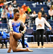 Florida's Trinity Thomas scores a 10 on the floor during a gymnastics meet at Penn State in State College, Saturday, March 7, 2020. Dawn J. Sagert photo