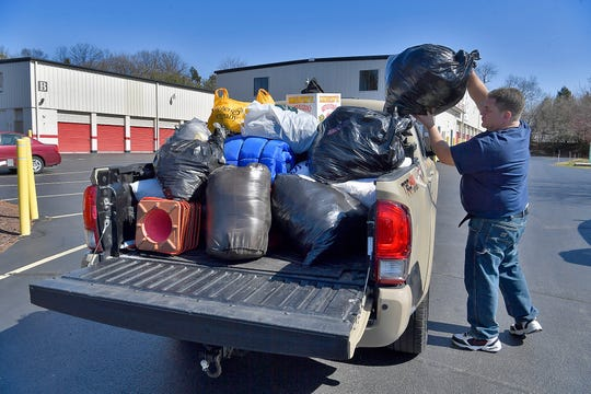 Fire fighter Brian Witmer and Southern PA Incident Network (SPIN) volunteer, loads collected donations for recent fire victims into a truck to place in storage, Sunday, March 8, 2020.John A. Pavoncello photo