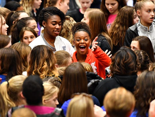 Florida's Trinity Thomas, right center, a former West York athlete, and her younger sister Tesia Thomas, currently a West York athlete, are surrounded by family and fans following a gymnastics meet at Penn State in State College, Saturday, March 7, 2020. Dawn J. Sagert photo