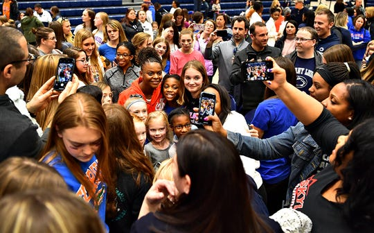 Florida's Trinity Thomas, center, a former West York athlete, is surrounded by family and fans following a gymnastics meet at Penn State in State College, Saturday, March 7, 2020. Dawn J. Sagert photo