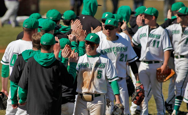 The York College baseball team celebrates a win on March 8, 2020. The York College season was shut down a few days because of the COVID-19 pandemic.