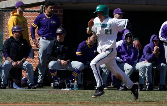 Jimmy Wiegers of York College sprints home on a double by teammate Brandon White as the Spartans host Elmira for an opening day double header, Sunday, March 8, 2020.