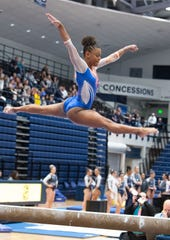 Trinity Thomas leaps high into the air during the dual meet between Penn State and Florida in the Rec Hall of Penn State University, March 7, 2020. The Gators took down the Nittany Lions.