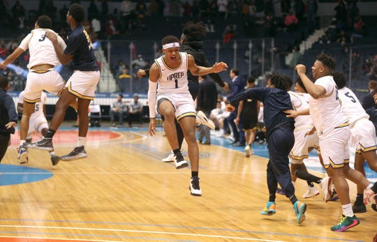 UPrep's Na'Zea Fowlks celebrates with teammates after winning the Class AA title over McQuaid.