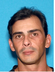 Manuel Scott Castellanos Date of birth: March 14,1978 Vitals: 5 feet, 10 inches; 180 lbs.; black hair/brown eyes Charge: Felony with a firearm
