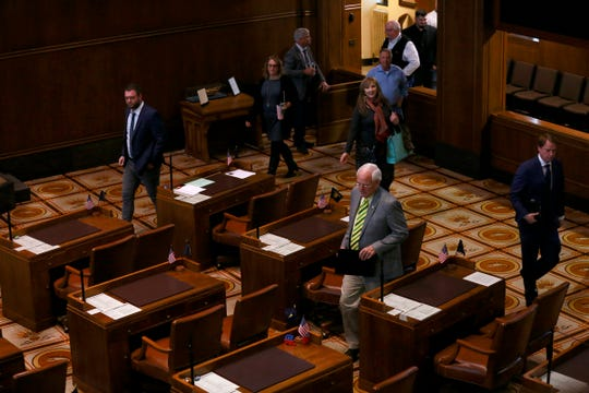 Senate Republicans walk onto the Senate floor in the Oregon State Capitol Building in Salem, Oregon, on Sunday, March 8, 2020. The Republican senators had been absent from the building since their protest walkout began Feb. 24.