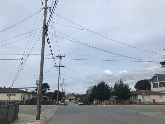 Power and telephone lines outside a home in Seaside. March 8, 2020.