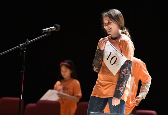 Winner Hannah McCabe smiles Saturday while competing in the 2020 Maryland Eastern Shore Regional Spelling Bee at UMES