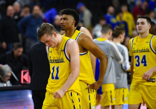 SDSU players walk off the court after losing a heartbreaking game to Purdue Fort Wayne for the Summit League tournament quarterfinals on Saturday night, March 7, at the Denny Sanford Premier Center in Sioux Falls.