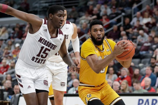 Valparaiso's Eron Gordon, right, heads to the basket as Missouri State's Lamont West (15) defends during the first half of an NCAA college basketball game in the semifinal round of the Missouri Valley Conference men's tournament Saturday, March 7, 2020, in St. Louis. (AP Photo/Jeff Roberson)
