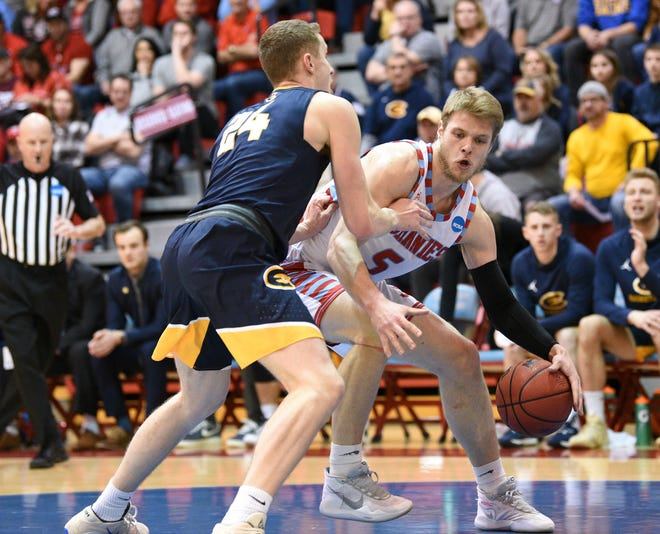 St. John's junior Zach Hanson works in the post against UW-Eau Claire in the second round of the DIII NCAA Tournament Saturday, March 7, 2020, at Sexton Arena.