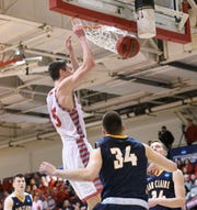 St. John's senior Lucas Walford throws down a dunk against UW-Eau Claire in the second round of the DIII NCAA Tournament Saturday, March 7, 2020, at Sexton Arena.