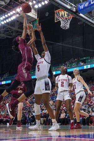 Mar 8, 2020; Greensboro, North Carolina, USA; Florida State Seminoles guard Morgan Jones (24) goes to the basket against NC State Wolfpack forward Jada Boyd (5) during the first half at the Greensboro Coliseum. Mandatory Credit: Jim Dedmon-USA TODAY Sports