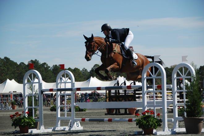 U.S. equestrian team member Maya Black rides Miks Master C during her stadium round at Red Hills Horse Trials 2020.