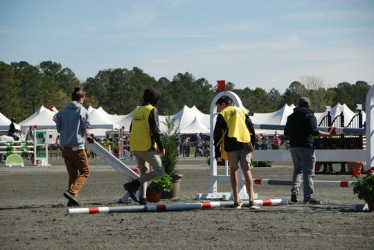 Pony club members work to put together a jump for the stadium jumping round at Red Hills Horse Trials 2020.