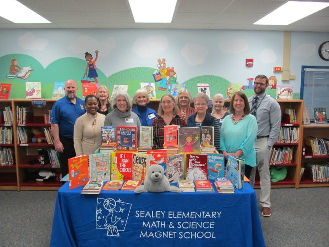 Friends, former colleagues and students of Dr. Sharon Hartman donated over 300 new books to the Sealey Elementary Math & Science Magnet School Library in her memory.