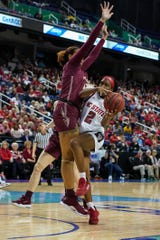 Mar 8, 2020; Greensboro, North Carolina, USA; NC State Wolfpack guard Kaila Ealey (2) gets pressure going for a shot by Florida State Seminoles forward Valencia Myers (32) during the first half at the Greensboro Coliseum. Mandatory Credit: Jim Dedmon-USA TODAY Sports