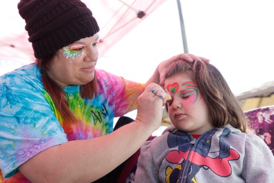 Eliana Shields, 3, gets her face painted by BJ's Party House during the Jewish Food Festival at Temple Israel Sunday, March 8, 2020.