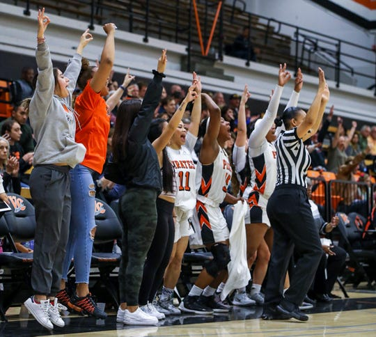 The Ventura College bench reacts to a 3-pointer against Irvine Valley in the CCCAA Southern California regional finals in Ventura. VC won, 70-67.