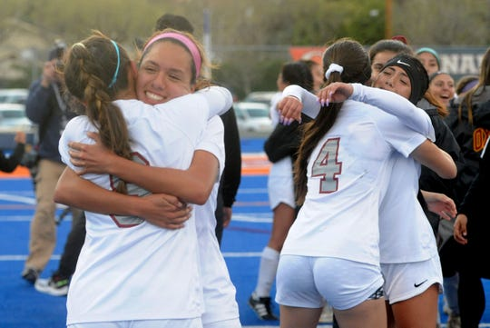 Oxnard High girls soccer players celebrate beating host Chaminade High 2-1 in the CIF-State SoCal Division III regional championship on Saturday.