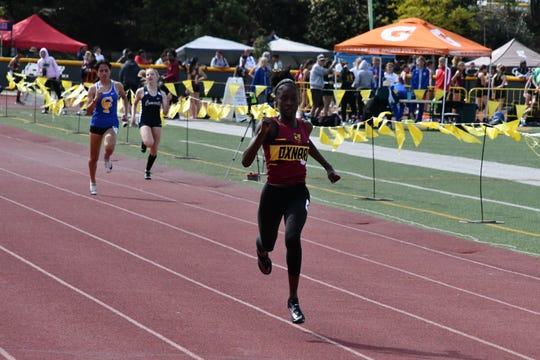 Arissa Thompson runs to the finish line to capture the 200 in a meet-record time of 24.94 seconds at the Don Green Invitational at Moorpark High on Saturday. Thompson also won the 100 in 12.40.