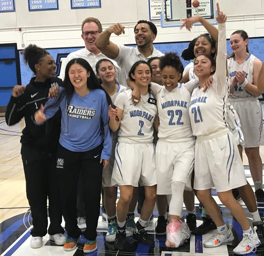 The Moorpark College women's basketball team celebrates after the top-seeded Raiders routed visiting Cypress, 70-39, in the CCCAA SoCal regional finals on Saturday night at Raider Pavilion.