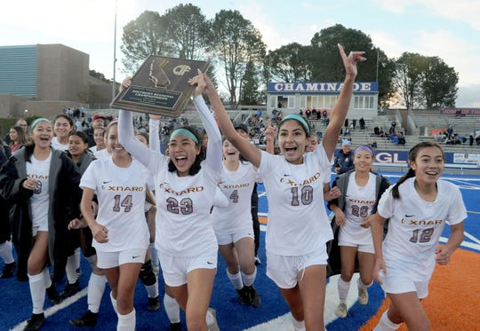 The Oxnard High girls soccer team celebrates its 2-1 win over host Chaminade High in the CIF-State SoCal Division III regional championship on Saturday.