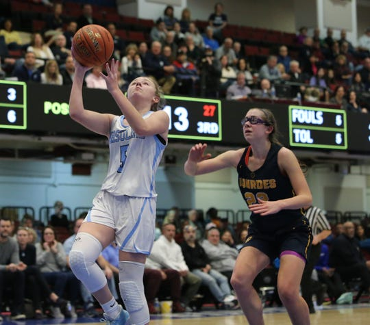 Ursuline's Meghan Casey (5) drives past Ursuline's Alexa Quirolo (22) during their 79-52 win over  Lourdes in the girls basketball Class AA section championship game at the Westchester County Center in White Plains on Sunday, March 8, 2020.