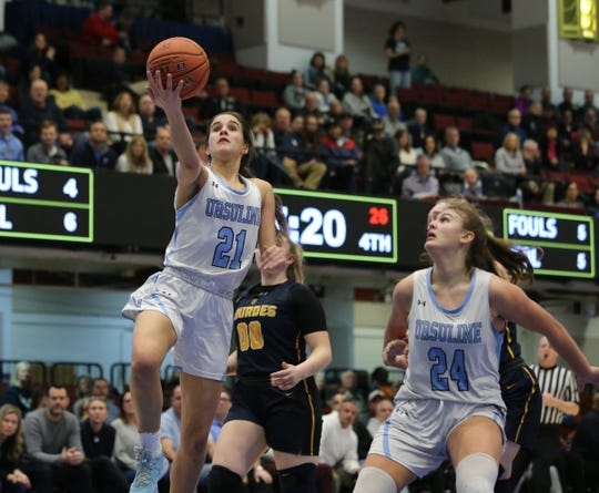 Ursuline's Sonia Citron (21) rolls in a shot during their 79-52 win over  Lourdes in the girls basketball Class AA section championship game at the Westchester County Center in White Plains on Sunday, March 8, 2020.