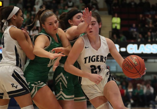From left, Putnam Valley's Eva Dechent (21) tries t get around Irvington's Aine Cleary (4) and Sara Gavagan (10) during the girls Class  B final at the Westchester County Center in White Plains March 7, 2020. Putnam Valley won the game 52-49.
