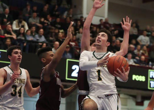 Hastings' Christopher Rotiroti (1) goes up for a shot in front of Valhalla'sRahsean Melvin (11) during the boys Class  B final at the Westchester County Center in White Plains March 7, 2020. Hastings won the game 56-54.