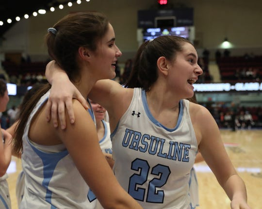 Ursuline's Sonia Citron (21), front, and Alexa Quirolo (22) celebrate their 79-52 win over Lourdes in the girls basketball Class AA section championship game at the Westchester County Center in White Plains on Sunday, March 8, 2020.