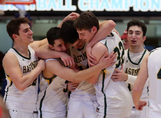Hastings players celebrate after defeating Valhalla 56-54 in the boys Class  B final at the Westchester County Center in White Plains March 7, 2020.