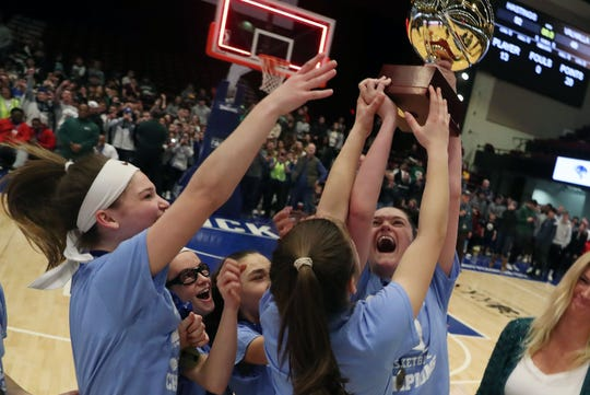 Putnam Valley players celebrate with the the gold ball after defeating Irvington 52-49 in the girls Class  B final at the Westchester County Center in White Plains March 7, 2020.