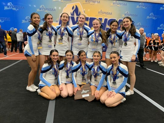 Ursuline's cheerleading team poses with the plaque after taking second place in the large-school/small-team division at the NYSPHSAA Cheerleading Championships in Rochester Institute of Technology on Saturday, March 7, 2020.