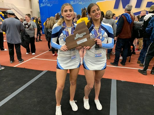 Ursuline's two seniors, Olivia Mondesando and Nina Campos, who have both been on varsity since 7th grade, pose with the plaque after taking second place in the large-school/small-team division at the NYSPHSAA Cheerleading Championships in Rochester Institute of Technology on Saturday, March 7, 2020.