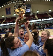 Ursuline players raise the gold ball after defeating Lourdes 79-52 girls basketball Class AA section championship game at the Westchester County Center in White Plains on Sunday, March 8, 2020.
