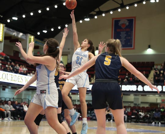 Ursuline's Sonia Citron (21) puts up a shot during their 79-52 win over  Lourdes in the girls basketball Class AA section championship game at the Westchester County Center in White Plains on Sunday, March 8, 2020.